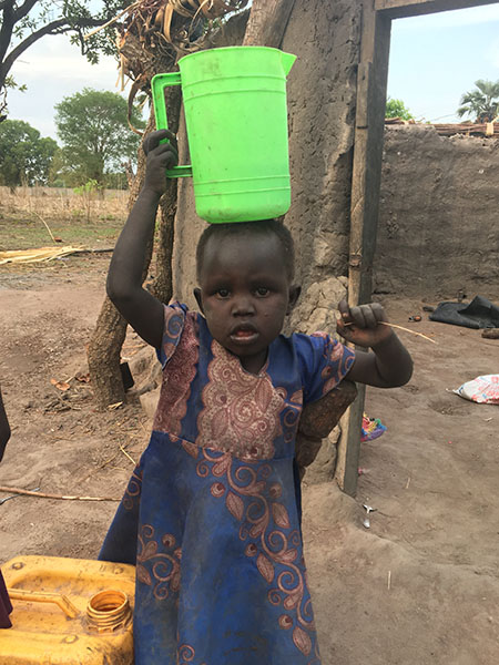 Child at bore hole Rumbek South Sudan