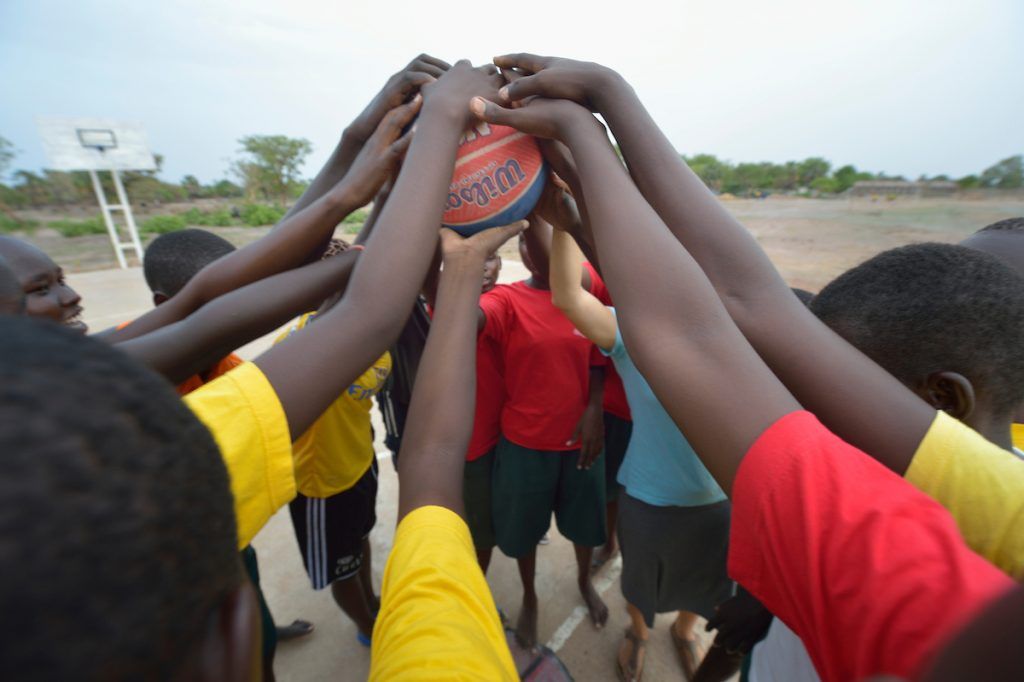 Students cheer as a group after playing basketball at the Loreto Girls Secondary School in Rumbek, South Sudan. The school is run by the Institute for the Blessed Virgin Mary--the Loreto Sisters--of Ireland.