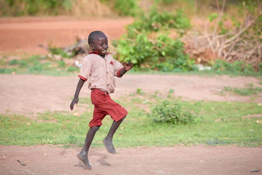 A boy runs to the Loreto Primary School in Rumbek, South Sudan. While focused on educating girls from throughout the war-torn country, the school, run by the Institute for the Blessed Virgin Mary--the Loreto Sisters--of Ireland, also educates children from nearby communities.